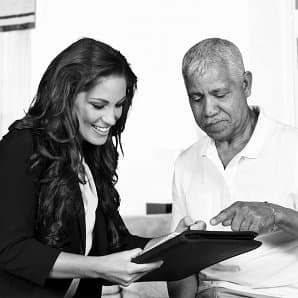 smiling female showing documents to the old man