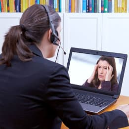 female consultant doing counseling using laptop