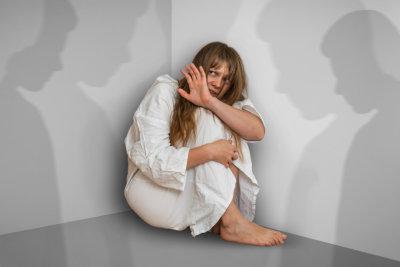 Scared woman with schizophrenia