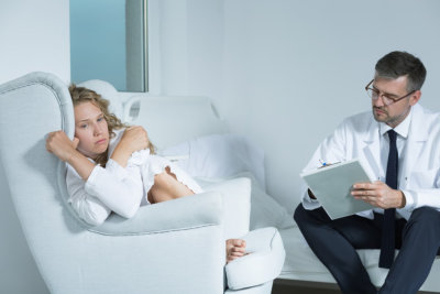 Young woman on a session with a psychiatrist